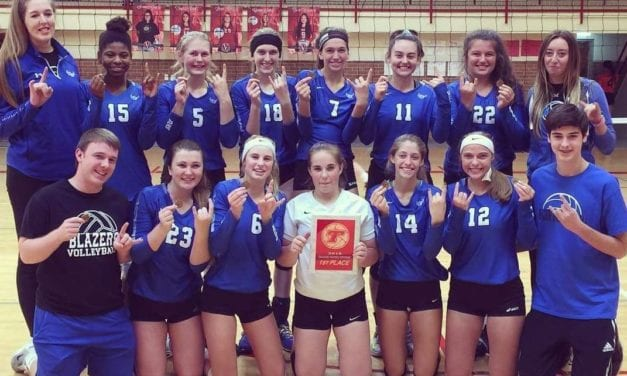 Varsity spikers take first at Tonganoxie